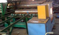 Pipe end induction heater for cylinder shrink